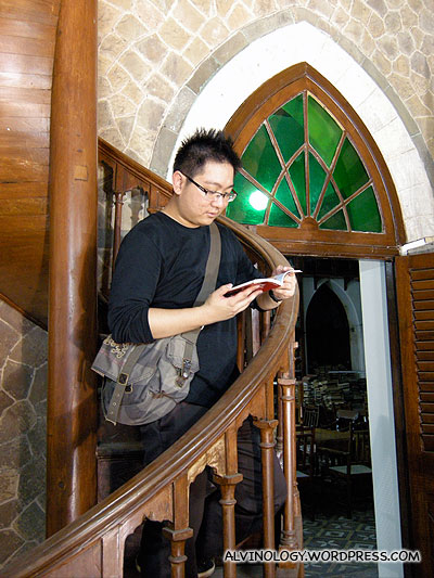 Reading on a spiral staircase