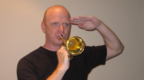 Groover practices the Bugle for his upcoming role of Teddy in Arsenic and Old Lace