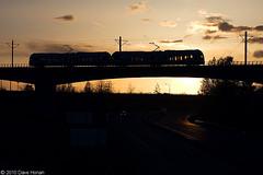 Link crossing SR 518 at sunset - SeaTac, WA (DWHonan) Tags: seattle railroad light train washington rail railway trains transit sound link commuter passenger seatac railroads tukwila