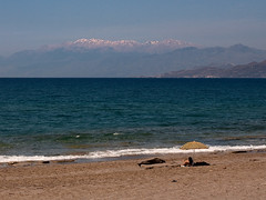 Spring contrasts (macropoulos) Tags: sea seascape mountains beach umbrella geotagged sand greece crete komos canoneos5d canonef100mmf28macrousm geo:lat=35019804 geo:lon=24759922 gettyimagesgreece1
