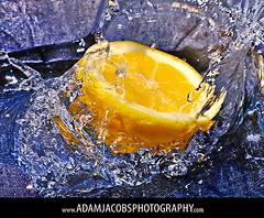 Lemon, no Lime. (AdamJacobsPhotos) Tags: blue food reflection texture water yellow drops lemon michigan flash fast arbor ann splash bog swell diyp diypbogfood