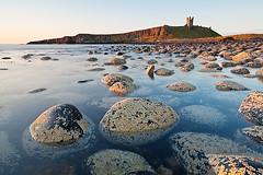 Dunstanburgh Castle (dtaylorphotography) Tags: uk sea england beach landscape outdoors coast unitedkingdom medieval northumberland northumbria coastline northeast englishheritage dunstanburghcastle dolerite johnofgaunt lilburntower whinsill dolorite