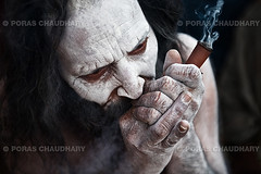 The Pot Smoker, Kumbh Mela, Haridwar, India ( Poras Chaudhary) Tags: portrait india beard intense nikon smoke smoking pot ash uttaranchal baba sadhu naga mela haridwar kumbh chilum uttarakhand