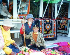 Smiling and Praying at the Same Time (Stanley Zimny (Thank You for 20 Million views)) Tags: china travel people colors smile smiling store praying hats tibet rugs