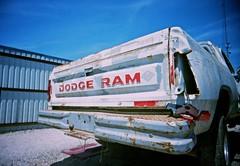 danger dodge (junkyard I) (chadinbr) Tags: blue sky film danger truck 35mm junk louisiana paint kodak wide bluesky batonrouge dodge junkyard blueskies busted 160vc portra vivitar wbr