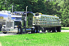 Black Pete pulling flatbed (myhotrod9) Tags: tractor truck semi pete trailer conventional trucking peterbilt 18wheeler flatbed tractortrailer bigrig class8 largecar