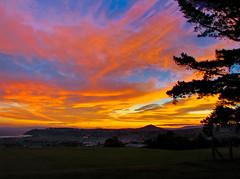 Sky Fire 2 (voyagernz) Tags: city trees sunset newzealand grass hill otago dunedin hdr