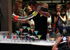 pouring 8 (eight) martini simultenously