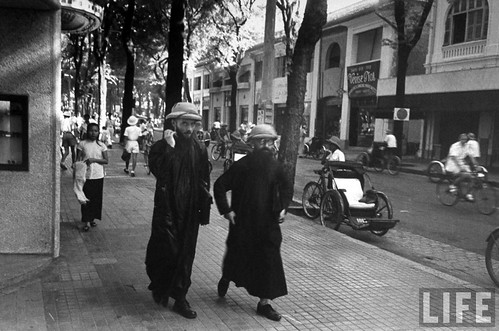Saigon 1948 - French missionaries walking along street, in French Indochina.