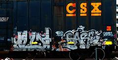 Celf - Bare (mightyquinninwky) Tags: 2005 railroad graffiti sticker bars bare 05 tag graf duke railway tags tagged tape railcar reflective boxcar graff graphiti freight bose htg csx trainart rollingstock celf jnet paintedtrain spraypaintart csxt reflectivetape movingart taggedtrain paintedsteel railroadart boxcarart easeup freightart wafflecar taggedboxcar paintedboxcar  paintedrailcar paintedfreight taggedrailcar taggedfreight 25