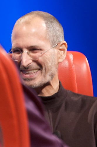 steve jobs smiling at something Walter Mossberg said