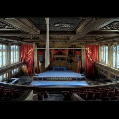Second Act (-michael) Tags: abandoned water woodwork theater pretty sad balcony stage stainedglass ceiling forgotten seats mezzanine damage tapestry craftsmanship