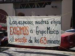 Grupo México protest banner