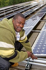 working at Ohio Solar Cooperative (by: Janet Century via Apollo Alliance)