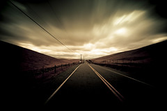 I've been to (songallery) Tags: california road longexposure sky usa cloud motion composition dark vanishingpoint moving wire nikon mood hill wide atmosphere line pole ambient livermore toned vignetting d3x afsvr1635mmf4g