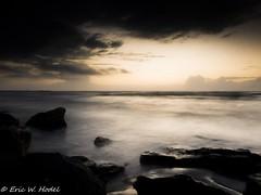 Waiting (Eric W. Hodel) Tags: ocean longexposure morning sky galveston beach gulfofmexico water colors sunrise sand rocks waves texas olympus e410 gtowneric ericwhodel wwwericwhodelphotocom staciepicks