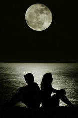 (ssj_george) Tags: leica boy sea people woman moon man black reflection beach water girl night dark lumix coast rocks sitting shadows nightshot silhouettes cyprus fullmoon panasonic moonlit moonwalk figures larnaca backtoback larnaka georgestavrinos fz28 ssjgeorge