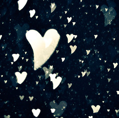 Snow hearts (~aspidistra~) Tags: snow love night dark hearts 50mm crossprocessed nikon bokeh shaped flash 9 coffeeshop explore fp pse actions d90 10365