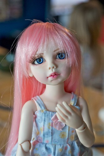 Anya, blushed and sueded, wearing a DollZone wig in pink.
