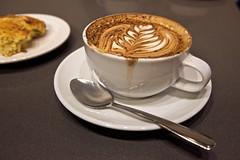 Latte art (qousqous) Tags: food cup coffee drink coffeecup coffeeshop spoon mug latte latteart saucer jjbean woodwards woodwardsbuilding cafe