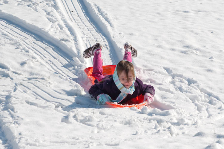 Kathryn sledding