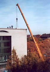 crane +3 (mikeasaurus) Tags: leica people color film yellow munich mnchen long crane no name small minimalism kran summilux lang 400asa lifting m4p 1435mm autaut staatskanzelei october2009