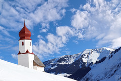 gates of heaven (gregor H) Tags: winter red mountain snow church austria kirche gettyimages redchurch vorarlberg bregenzerwald damüls
