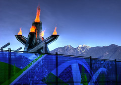 Vancouver 2010 Olympic Cauldron (Brandon Godfrey) Tags: world pictures winter mountain snow mountains art bronze vancouver fence silver landscape fire photography gold scenery bc photos native pics earth britishcolumbia sony rocky scene canadian flame pacificnorthwest northamerica olympics dslr range capped cauldron hdr highdynamicrange waynegretzky 2010 olympiad a300 thechallengegame challengegamewinner