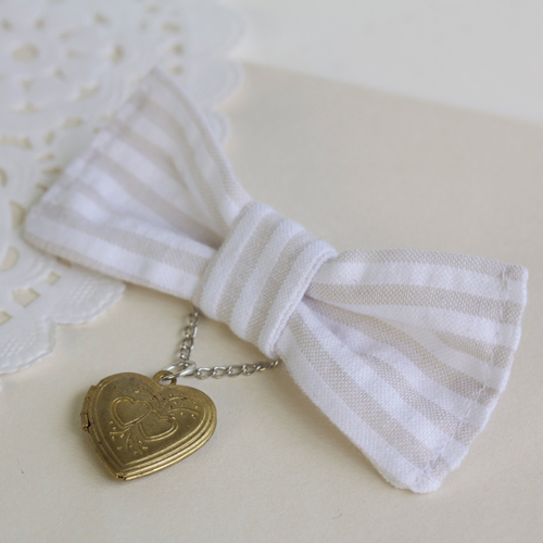 bow/locket brooch