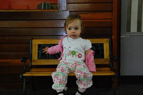 Little girl, little bench