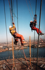 Connecting the main cables by rope access on the Millenium Dome (Craig Hannah) Tags: london work photography photo industrial photos hannah greenwich rope images photographs craig job abseiling height milleniumdome career abseil ropeaccess theo2arena ropeaccesstechniques workatheights imagesropeaccess ropeaccessphotos craighannah