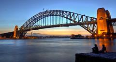 Coat Hanger (AussieBarracuda) Tags: longexposure bridge sunset water couple sydney australia harbourbridge hdr canon1740lf4 rathernoisy canon5dmkii dangiwishthesunsetwasbetter ahwellwhatcanyoudo needtoreadsomemoreonthishdrstuff exceptnowevenattimessydneyseemsrelaxedcomparedtosingapore thoughiknownexttimeimbackiwontsaythat grrrrthiscouldofbeensomuchbetterwithamorecolourfulsunset oknomorecomplaining