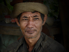 Charming Lao man with soulful eyes (Bn) Tags: poverty life smile topf50 bravo character conservation streetportrait atmosphere personality national area friendly isolation laos topf100 soulful groups biodiversity sincere tms etnic hardlife warmsmile harmonize smilingman tellmeastory beautifulsmile 100faves 50faves bolavenplateau emotionalportrait peoplesdemocraticrepublic smilewrinkles champasakprovince friendlyandhospitable yourpreferredpicture academiahispanoparlantedeautodidactas secondindochinawar laopeople shininglikeastar tailao meuanglao peoplesupportthemselves thelaoeconomy visipix richinhistoryandculture peoplefromplanetearth 4millionpeopleest supportbyagriculture rurallifeinlaos laotiansmile portraitfullofcharacter amillionsmilesinlaos laowomenportrait workfullofhumanity friendliestlaosmile saravane themostheavilybombed landofonemillionsmiles senseresmile meninlaos smilingelderyman salavanmeansonemilliondays anendearingsmile charminglaosmile charminglaomanwithsoulfuleyes portraitofanelderyman soulfullaoman