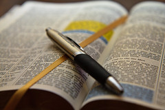 Open Bible with pen