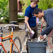Professor Peter Dula, Ph.D., and a student make ice cream with a bicycle-powered ice cream maker as part of Earth Day celebrations.