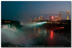 Niagara Falls Illuminated at Night (:: Igor Borisenko Photography ::) Tags: longexposure sky mist water colors night clouds buildings reflections lights niagarafalls waterfall colorful dusk falls illuminated pa hotels erie tones beams allrightsreserved realistic nikond80 igorborisenkophotography