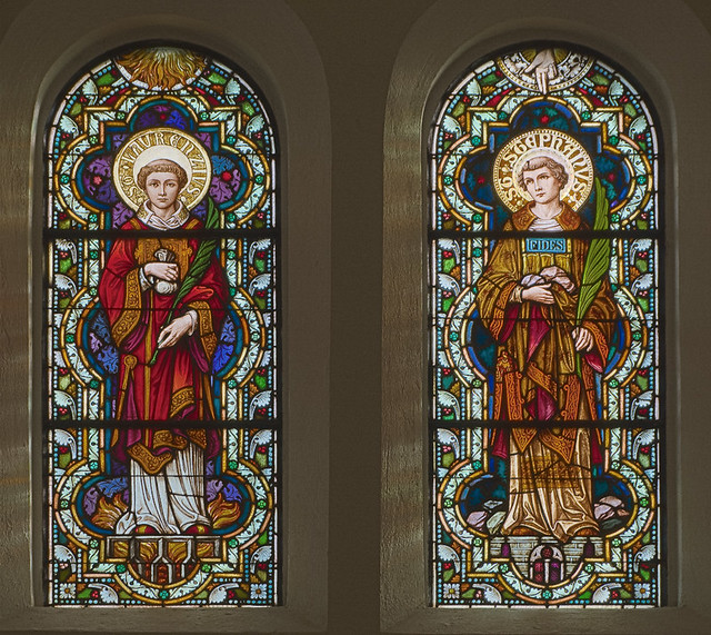 Saint Meinrad Archabbey, in Saint Meinrad, Indiana, USA - stained glass windows of the deacon-martyrs Saint Lawrence and Saint Stephen