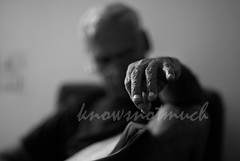 fingertip (knowsnotmuch) Tags: 50mm newspaper dof hand nail fingers tashan