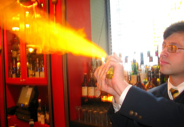 Bartender and an absinthe flame by Caroline on Crack
