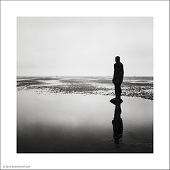 Statues in the Mist (Ian Bramham) Tags: bw film beach mediumformat landscape photography photo minolta fineart ilford crosby antonygormley autocord anotherplace xp2super400 artinbw ianbramham