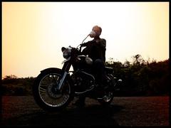 Now where do we go? (Siddharth Menon) Tags: red sky brown sun india classic silhouette set backlight ray maroon royal style bull retro motorcycle bullet 500 mumbai ban c500 enfield menon crome vashi siddharth