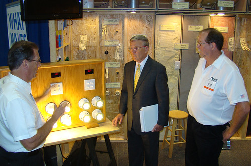 (Left to right)  Bob Dickey Discussing features of the Wall With North Dakota Senator Byron Dorgan. Also shown: Aaron Ridenour at a North Dakota Energy Expo.
