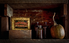 Garage Still Life (nybray) Tags: wood dark pumpkin cigarbox glassbottles canon5dmarkii