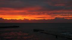 11-04-2010 T1i Florida Sunrise 052 (James Scott S) Tags: ocean morning light red orange usa sun beach yellow clouds sunrise canon scott eos rebel dawn james surf florida united palm atlantic ii di inlet fl rays states af rise dslr tamron shining vc 500d f3563 18270mm t1i