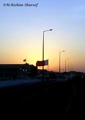 Evening and The flag of Qatar (M.RISHAN SHAREEF) Tags: nature blue black culture red evening earth enjoy yellow festival thenature white lighting sky light night orange qatar souq sun street building