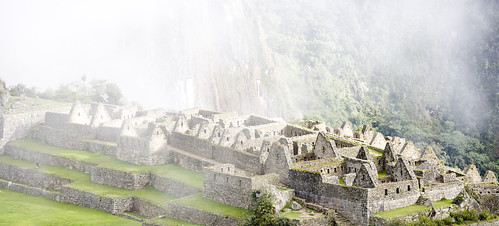 The beautiful peaks of the 'common district' shine through the clouds early in the morning on Machu Picchu.