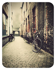 bruges in vintage (matthewheptinstall) Tags: travel classic bike bicycle vintage alley europe fuji belgium transport retro bruges aged compact dated 5photosaday filmeffect florabella impressedbeauty