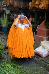 Man with Flowers (Jonathan!) Tags: flowers india flower market kolkata calcutta ind