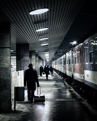 Dark passenger. (next_in_line) Tags: street city travel station night train canon walking 50mm pier waiting noir budapest luggage dexter pulling 400d