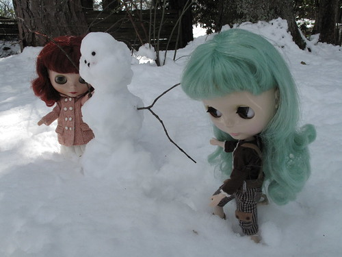 Gretel and Harmonee make a snowman together.